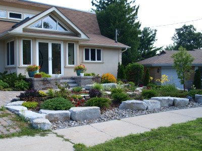 Who needs a lawn? Replace it with planting of shrubs and perennials.
