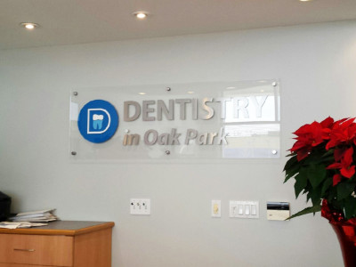 Polished acrylic reception sign with CNC cut aluminum letters and logo, Oakville, Ontario.