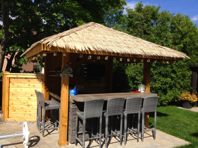 Custom tiki pavilion with thatch roof