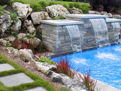 mossy boulders around water feature