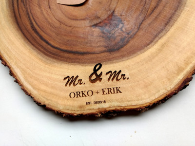 engraved names in cheeseboard for a wedding gift.