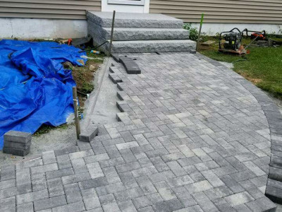 During - New walkway, granite stairs, irrigation system, shed platform and side parking area (Woburn, MA)