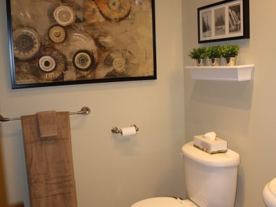 AFTER: Bathroom Redesign A fresh coat of paint, new linens, artwork and a selection of small accessories is all it took to update this space