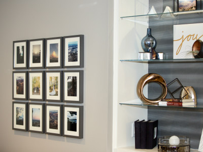 An existing built-in bookcase  was given an facelift and a gallery wall of treasured photos installed.