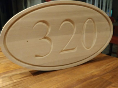 Routed cedar wooden sign, oval