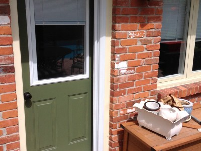 New exterior rear door with pocket screen door installed