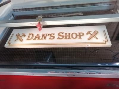 Cedar personalised wooden workshop sign being laser engraved. Hamilton Ontario