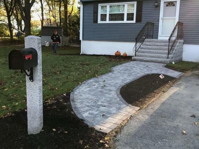 During - New walkway, granite stairs, irrigation system, grading, mulching, sod and granite mailbox post (Stoneham, MA)