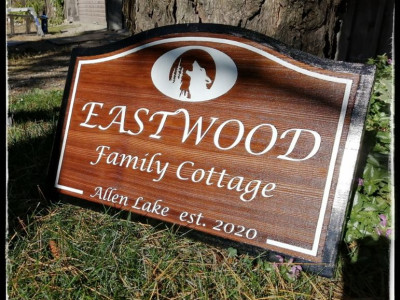 Custom personalized wood cottage sign, western red cedar, laser engraved with clear yacht varnish and one shop paint. Ontario Canada