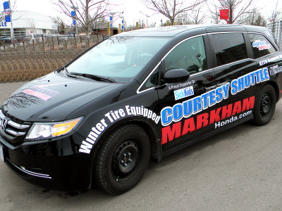 Customer Shuttle Graphics With Winter Tire Marketing