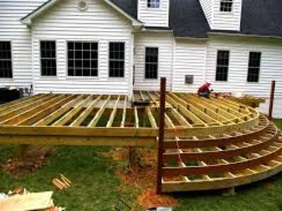 Custom deck with curved stair under construction.