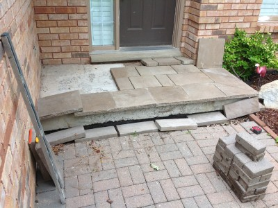 Doing a dry fit for the stone on the front step. You can see the old interlock at bottom of picture