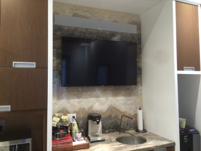 "48"" TV Mounted on Granite in a Boardroom"