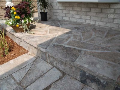 A natural stone porch overlay will be the highlight of any front entrance