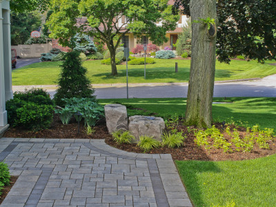Patio walkway and gardens can be integrated to create a cohesive look.