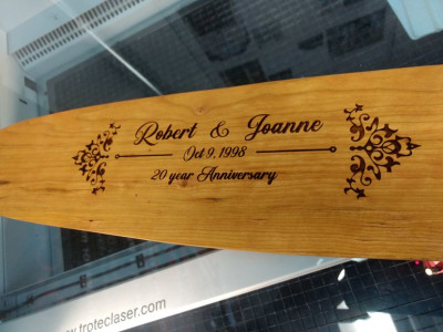 Laser engraved names on a wooden paddle, anniversary, Ontario Canada