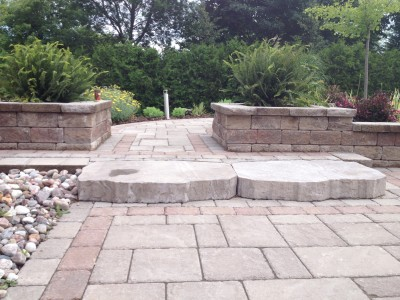 Matching planters are a key to the landscape design of this space