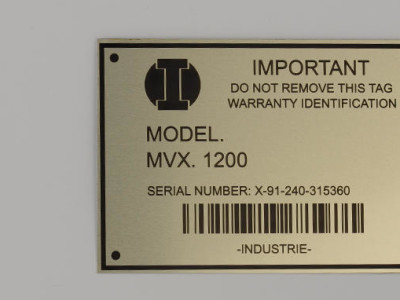 Laser marked metal tags with barcodes.