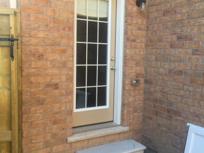 Photo 1 - home with out the storm door