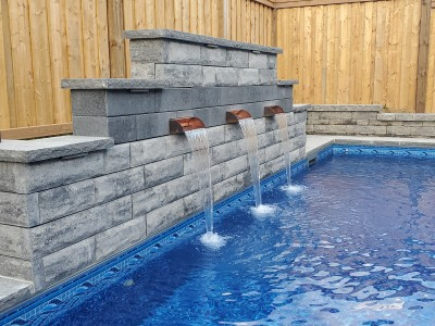 This water feature is a focal point for this backyard retreat