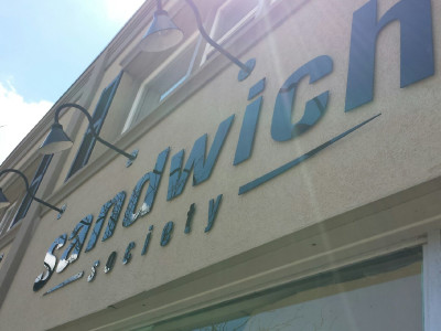 "1/4"" laser cut acrylic letters for store front sign in Oakville."