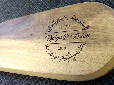 Laser engraved wooden cheeseboard.