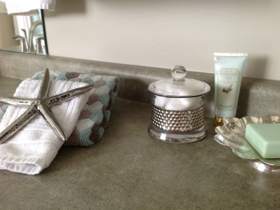 A home near the beach inspired this simple vignette in a master bathroom