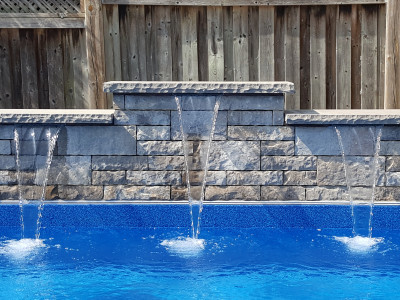 Sheer decent water feature, permacon wall stone and india coping