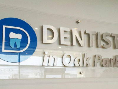 Clear acrylic sign with aluminum lettering for dental office, Oakville, On.