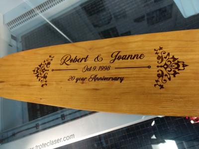 Laser engraved wooden oar.