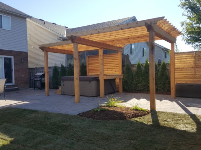 Backyard included large cedar pergola, privacy screens, plantings, and a paver patio