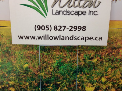 Coroplast lawn sign with ground spike for landscaping companies.