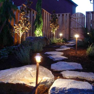 Natural stone walking paths and lighting.