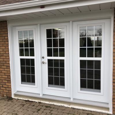 Triple garden door system with venting lites.
