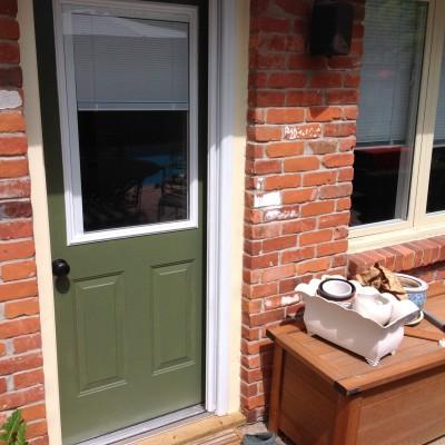 New exterior rear door with pocket screen door installed