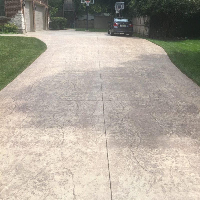 BEFORE: Worn Stamped Concrete