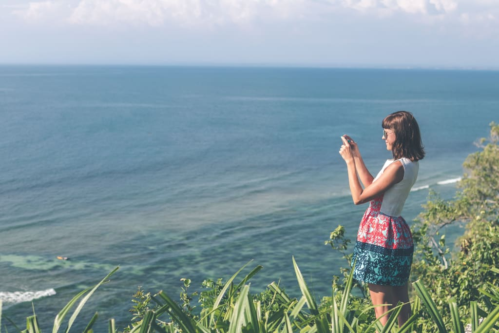 digital nomad woman taking a photo in Bali, Indonesia