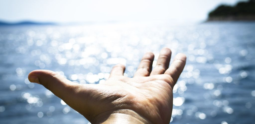 hand and the ocean