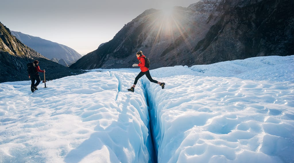 woman-solo-enjoying-the-glaciers-in-new-zealand