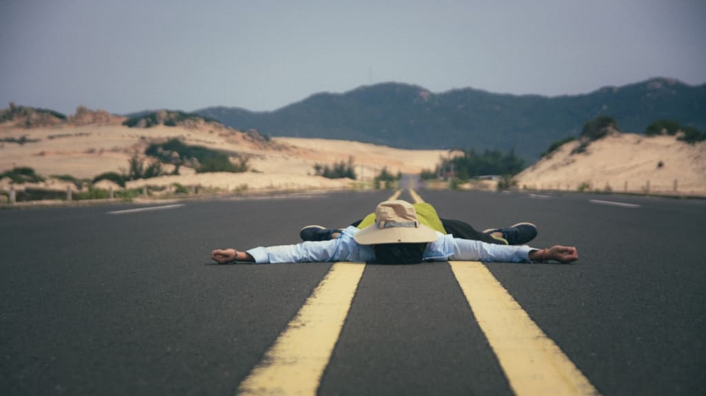 man lying on the road