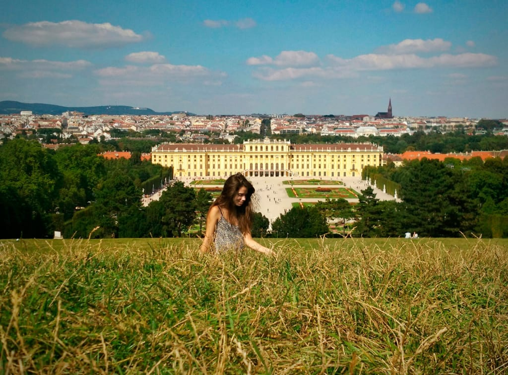 woman-solo-travelling-though-the-fields-of-austria
