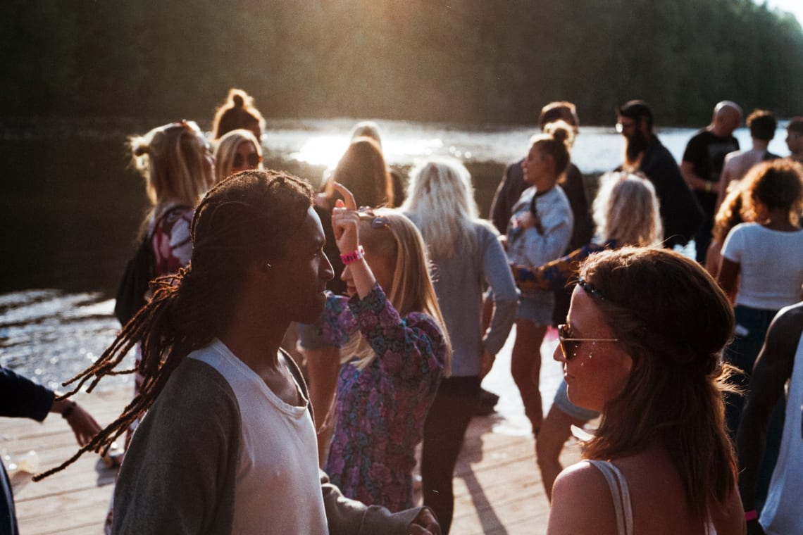 Young people mingling at an outdoor social gathering