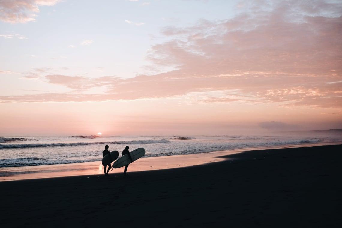 Two surfers, Huanchaco, Peru