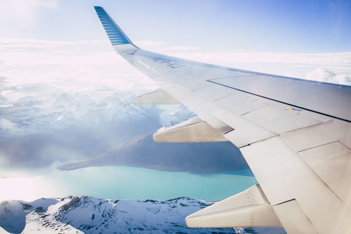 Flight views over snowy mountains