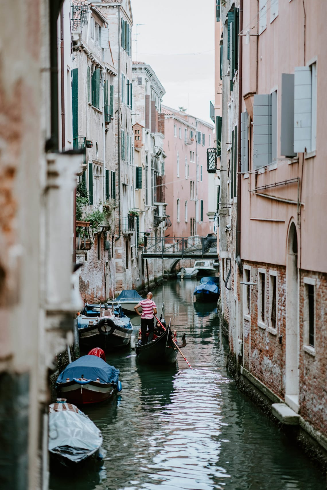 Man rowing down canal, Venice, Italy, Europe