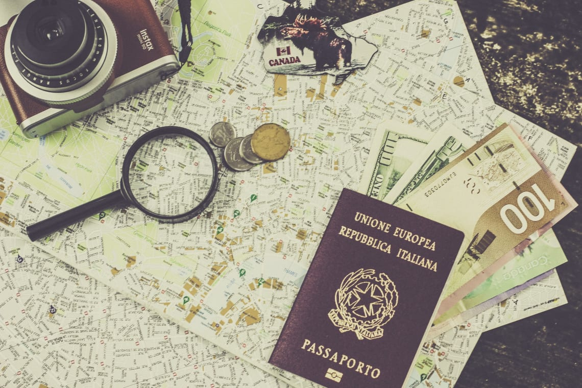 Passport, maps, camera, and currency