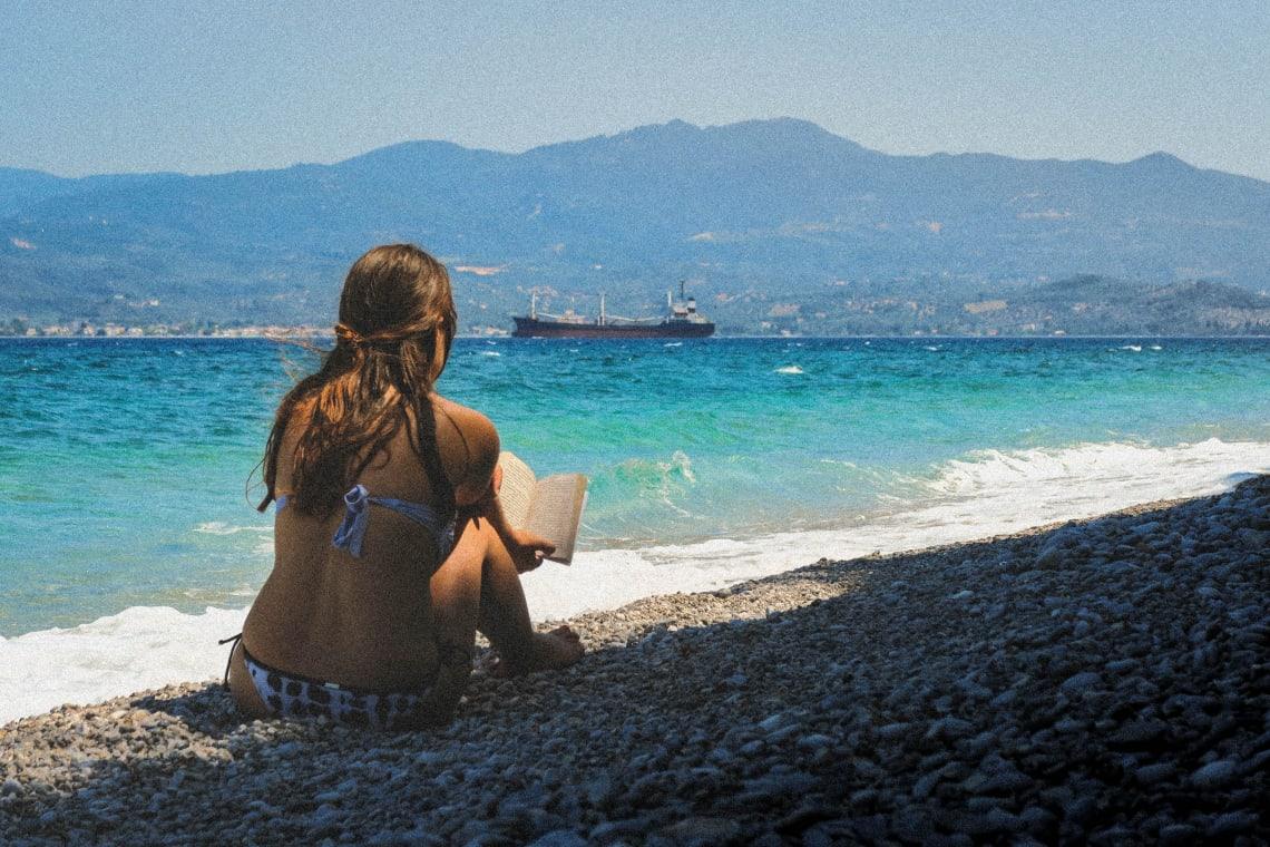 Girl enjoying alone time by the beach, Glifa, Greece