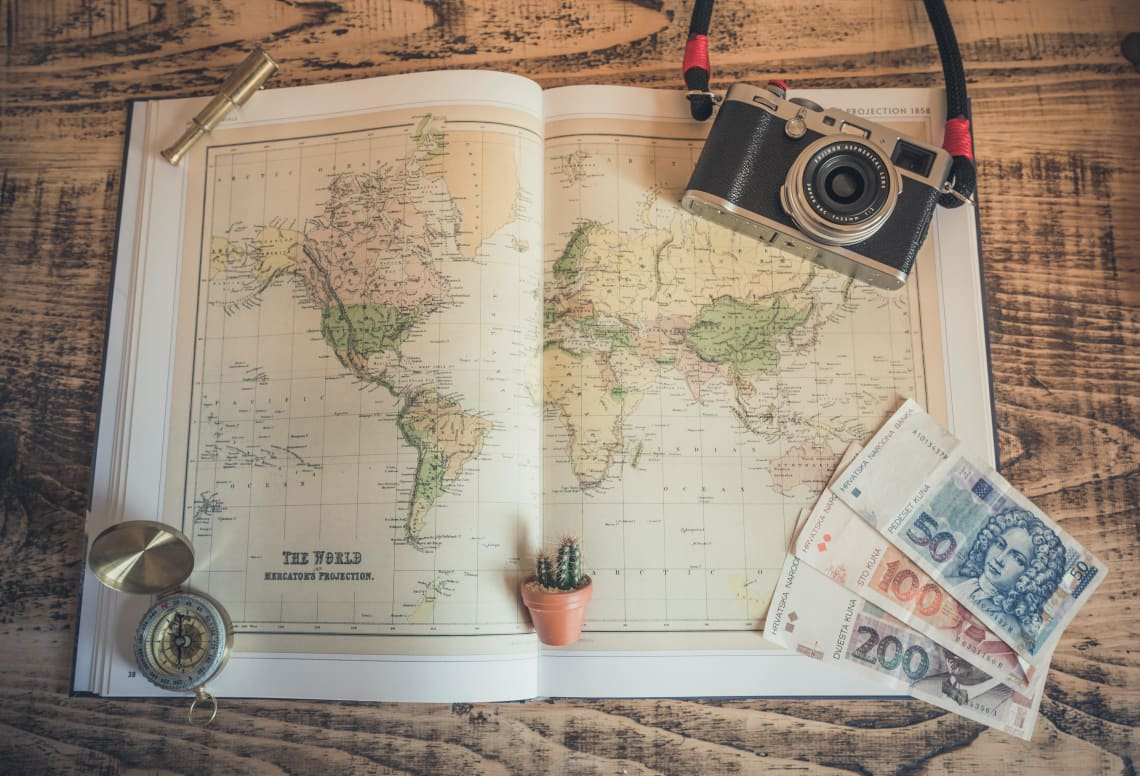 Map, compass, camera, currency