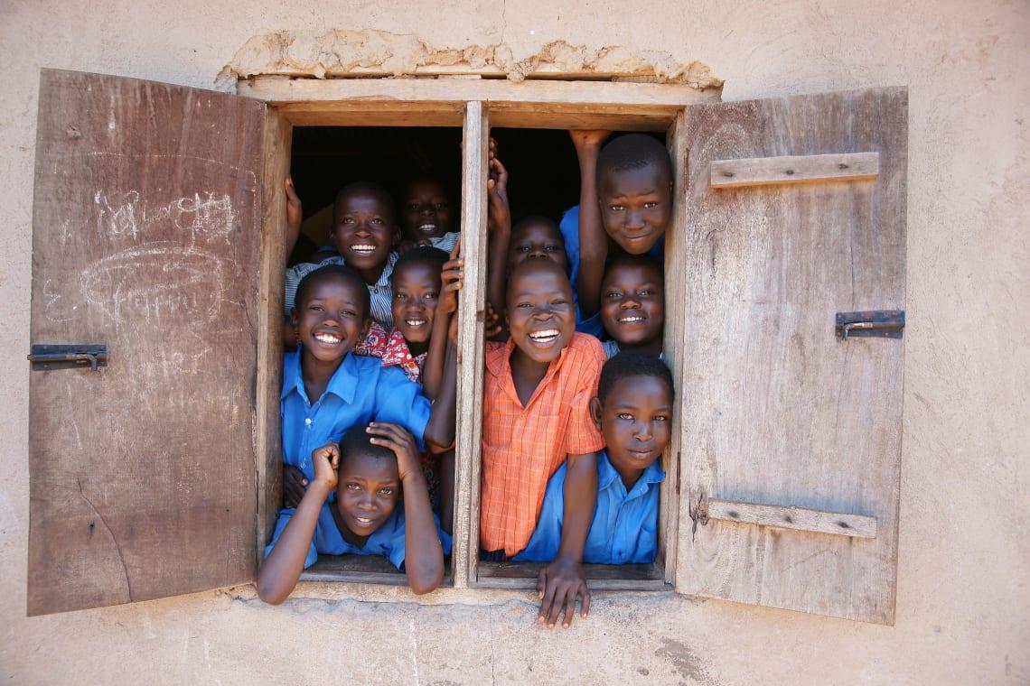 Children smiling at school, Uganda