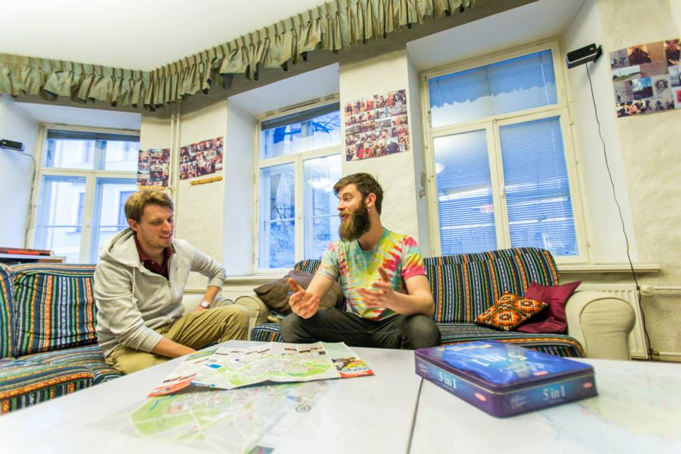 hostel recepcionist interacting with new guest